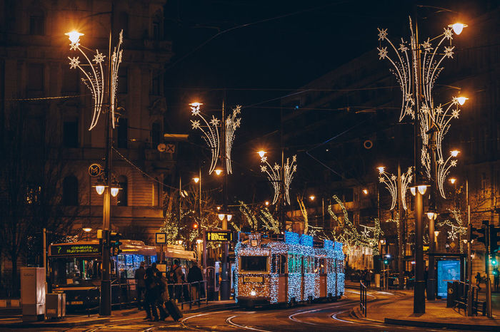 Budapest Tram Architecture Building Exterior Built Structure City City Life Illuminated Large Group Of People Night Nightlife Outdoors People Sky Street Light