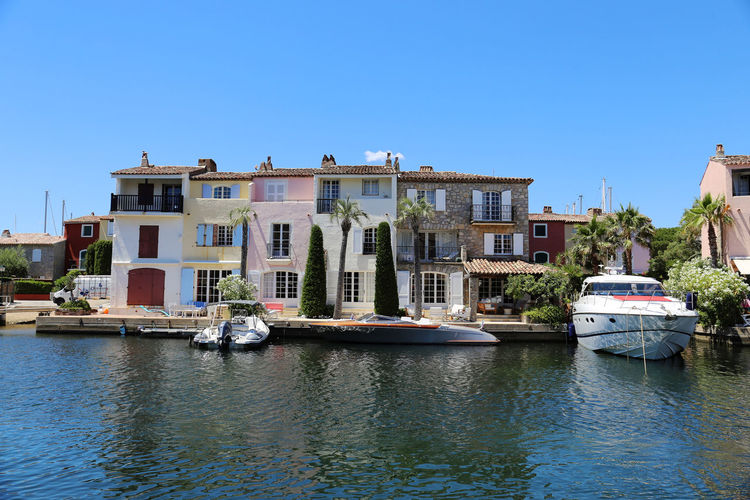 Street on the water in the port Grimaud, France Architecture Architecture Blue Boat Building Exterior Built Structure Canal City Cityscape Clear Sky Day France Grimaud Landscape Mode Of Transport Nature Nautical Vessel No People Outdoors Palm Palm Trees Sky Water Water Reflections Waterfront