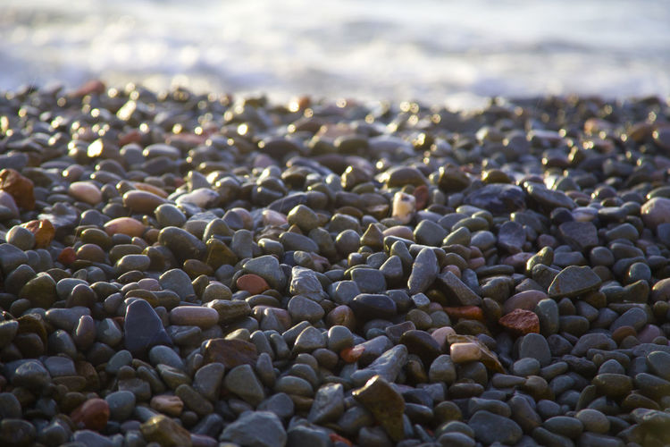 Sea pebble Abundance Backgrounds Beach Beauty In Nature Close-up Day Focus On Foreground Full Frame Large Group Of Objects Nature No People Outdoors Pebble Pebble Beach Rock - Object Sea Selective Focus Shore Stone Stone - Object Surface Level The KIOMI Collection Tranquil Scene Tranquility Water
