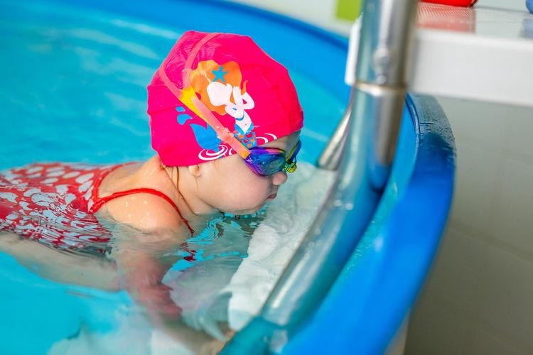 Cute girl at swimming pool