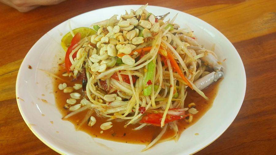 Papaya salad with crab Korat Thailand Spicy Thai Food Thailand Street Foods Thaistyle Crap Food Thailand Thai Food Somtum With Crap Italian Food Plate Comfort Food Table Tomato Chopped Gourmet Vegetarian Food Close-up Food And Drink