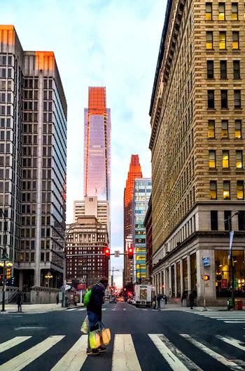City Street Amidst Modern Buildings Against Sky