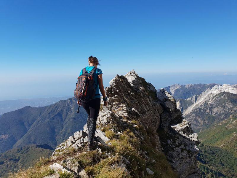 trekking @ Monte Corchia, Alpi Apuane, Tuscany, Italy @DianaCavalleri #HikerDK Hikingadventures EyeEm Selects Italy Mountain Apuane Mountains Apuane Women Hiker Woman Hiking Full Length Clear Sky Adventure Standing Sea Climbing Hiking Backpack Blue Climbing Rope Hiker Mountain Climbing Safety Harness