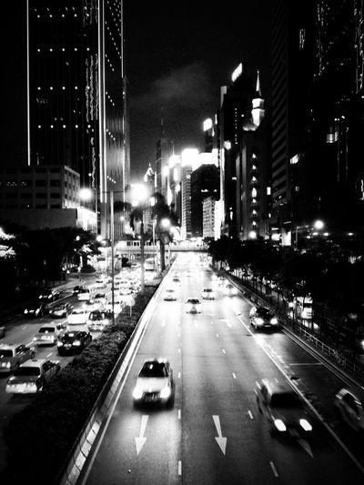 Architecture City HongKong Life Architecture Blackandwhite Car City City Life Cityscape Illuminated Mobilephotography Motion Night People Road Street Streetphotography Town Traffic Transportation