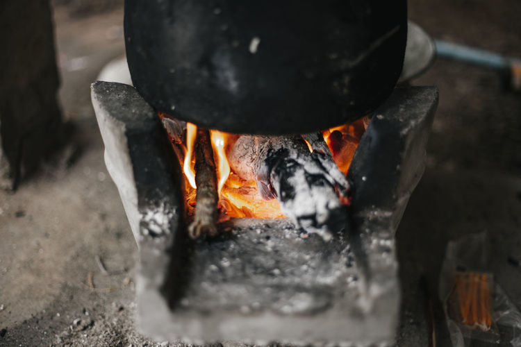Heat - Temperature Fire Burning Fire - Natural Phenomenon Flame No People Glowing Close-up Preparation  Nature Wood - Material Selective Focus Indoors  Black Color Pan Orange Color Firewood Food And Drink Day Food Metal Industry