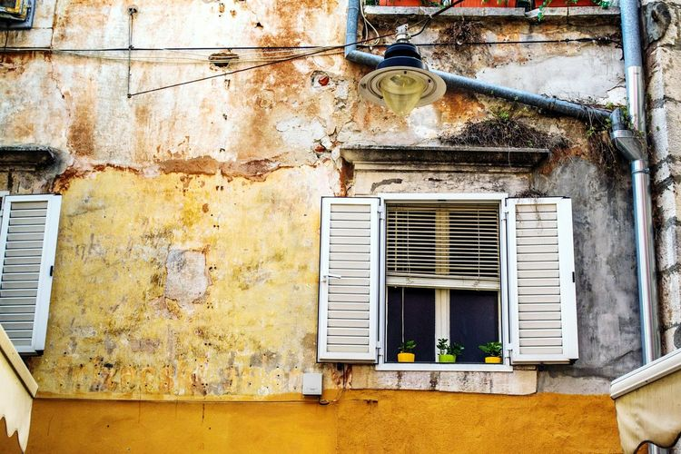 EyeEm Selects Architecture Built Structure Building Exterior Air Duct Window No People Day Outdoors Electricity  Air Conditioner Technology Close-up Yellow