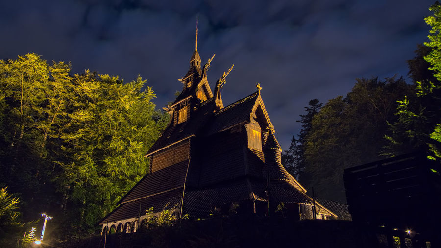 Stave church Fantoft Bergen Architecture Built Structure Building Exterior Tree Plant Low Angle View Building Nature Sky Place Of Worship Religion Belief No People Spirituality Illuminated Night The Past History Outdoors Spire