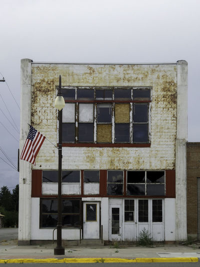 Abandoned Buildings Architecture Building Exterior Day Flag Light Post No People Patriotism Sky Small Town America