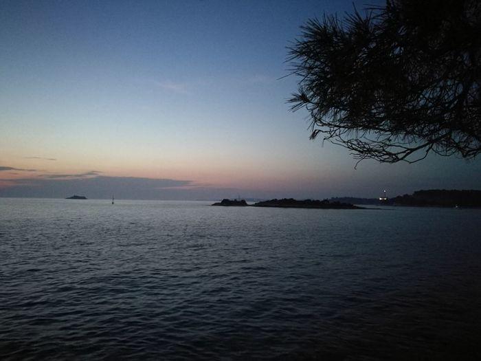 Rovinj Croatia Crveniotok Water Astronomy Clear Sky Sea Sunset Tree Space Galaxy Blue Beach View Into Land Patchwork Landscape Seascape Horizon Over Water
