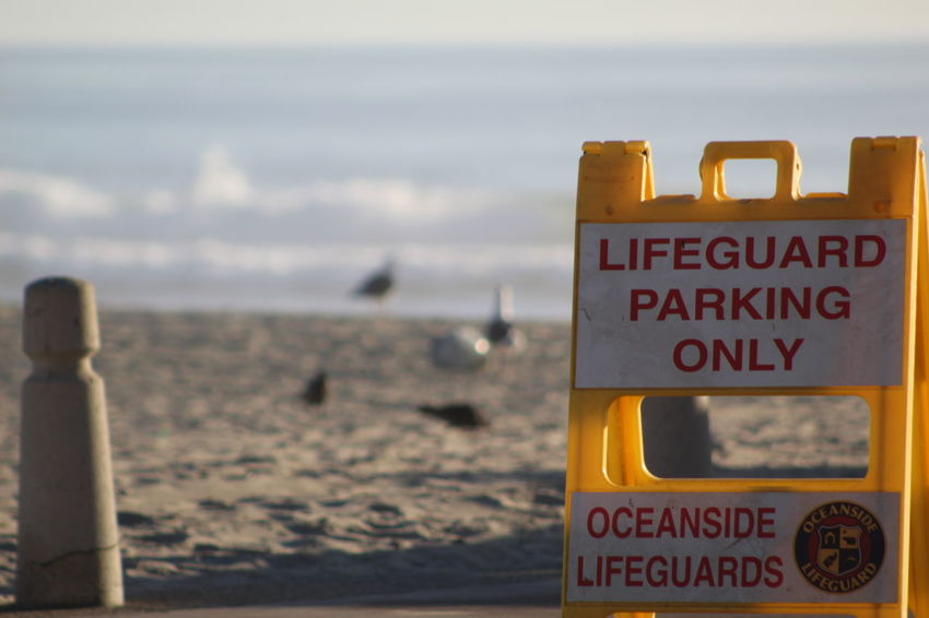 Beach Text Sea Safety Sand Communication No People Vacations Sky Close-up Outdoors Horizon Over Water Day Travel Destinations Landscape Water Sunlight Nature Oceanside Pier Oceanside Afternoon Oceanside, Ca