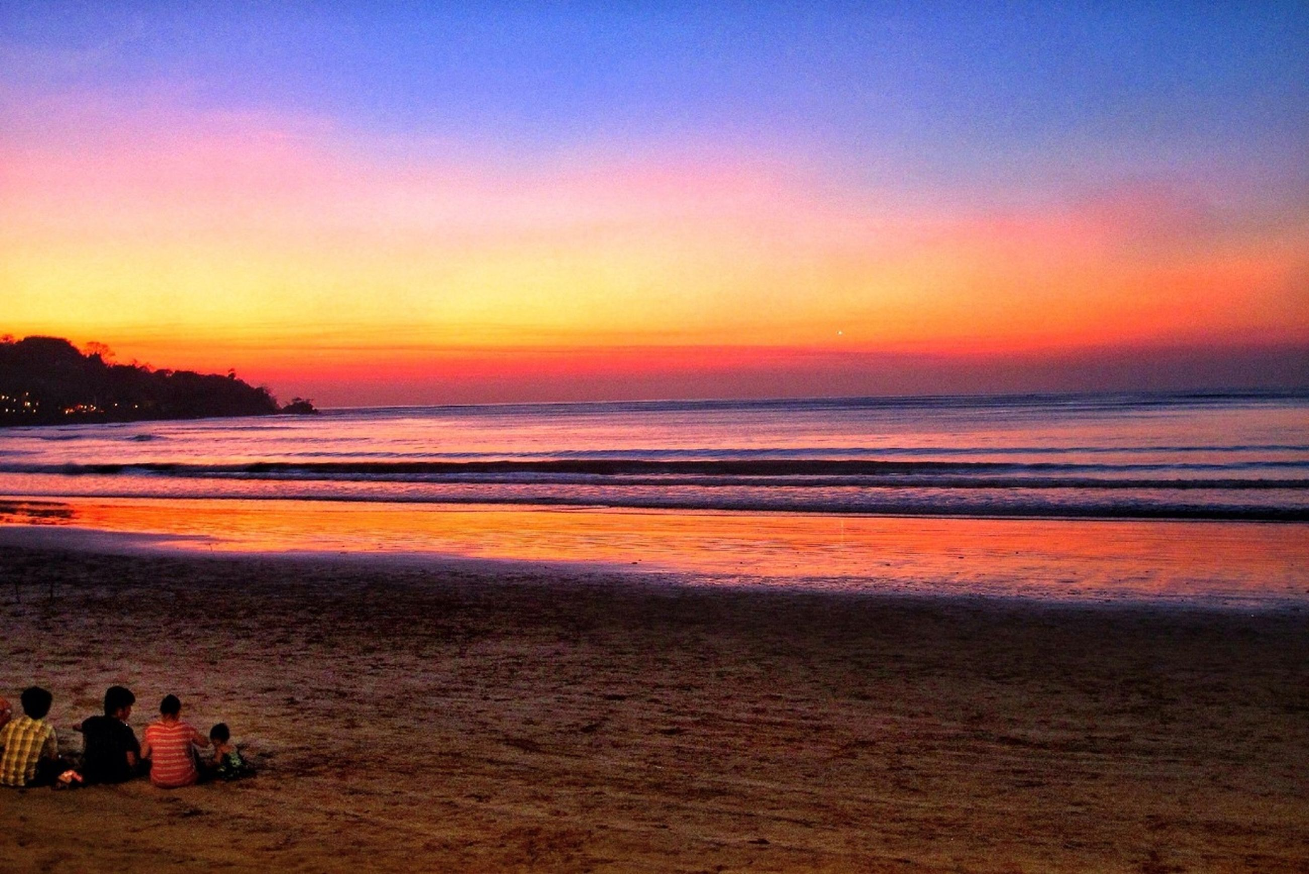 sea, beach, sunset, water, horizon over water, scenics, shore, tranquil scene, beauty in nature, tranquility, sky, sand, idyllic, orange color, nature, wave, coastline, silhouette, incidental people, dusk