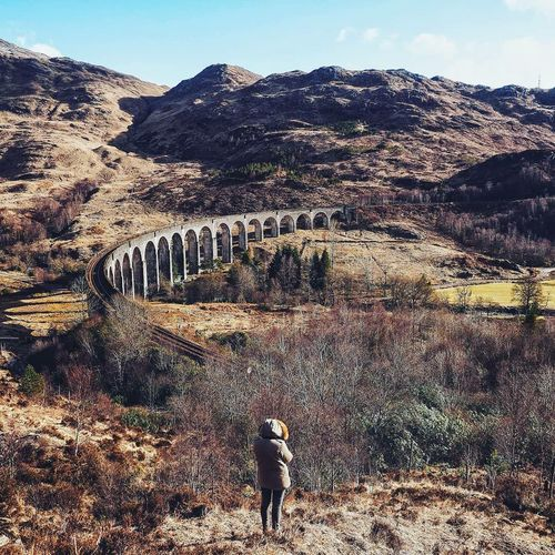 Harry Potter Scotland Arch Architecture Beauty In Nature Bridge - Man Made Structure Built Structure Connection Day Harrypotter Landscape Mountain Mountain Range Nature One Person Outdoors Plant Real People Rear View Scenics Scotalnd Sky Transportation Travel Water