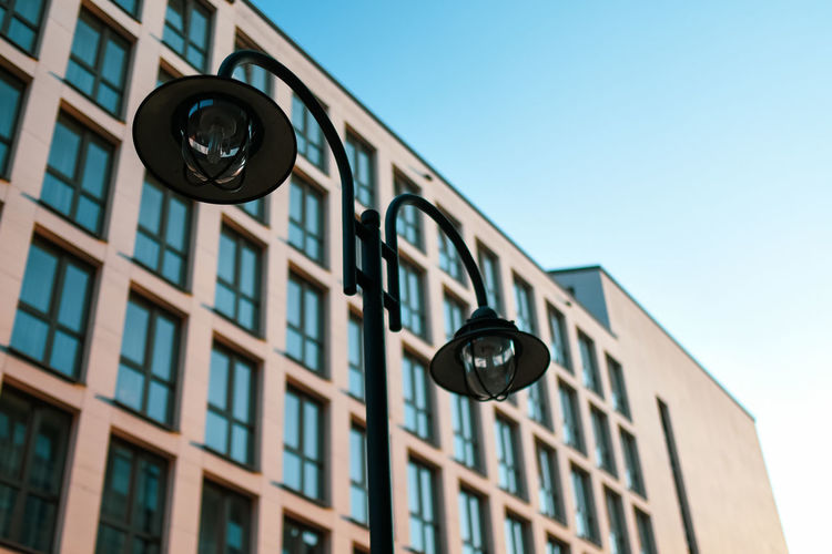 Urban Hoffi99 Urban Skyline No People Day Outdoors Building Exterior Sky Architecture Low Angle View Built Structure Clear Sky Building Lighting Equipment Street Light City Nature Focus On Foreground Street Clock Time Metal Wall - Building Feature Light Light Fixture