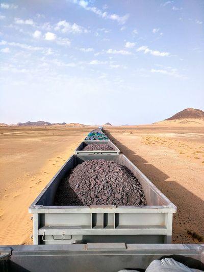 Iron Ore Train, Mauritania North Africa Adventure Travel Mauritania Train Industry Backpacking Travel Destinations Iron Ore Oasis In The Desert Sahara Sand Arid Climate Heat - Temperature Sand Dune Landscape Sky Desert