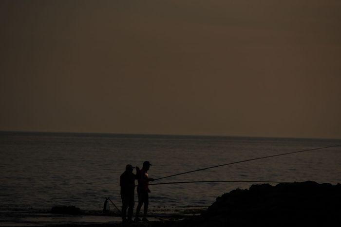 against light. contre jour. mere. pêche. lebanon. beirut Silouette Photography Reflection Rawshe Street Beirut Pêcheur Peche Mere Water Sea Full Length Fisherman Fishing Tackle Standing Sunset Silhouette Men Fishing