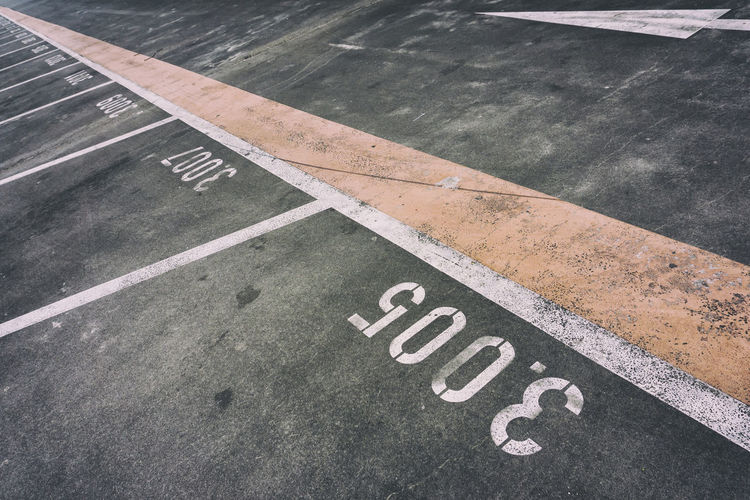 High angle view of marking at parking lot