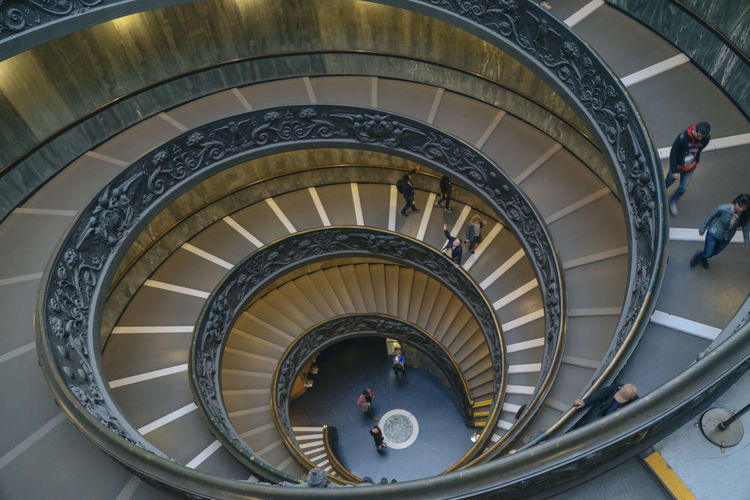 Spiral Architecture Spiral Staircase Spiral Built Structure Steps And Staircases Staircase Indoors  Railing High Angle View Day Directly Above Design Real People Pattern Men Women Group Of People Shape Moving Down Museum EyeEmNewHere
