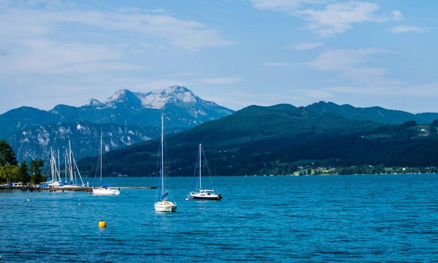 Attersee Austria Blue Boats Holiday Lake Lakeside Lakeview Mountains No People Outdoors Sailing Sea Ship Ships Sports Summer Swimming Water