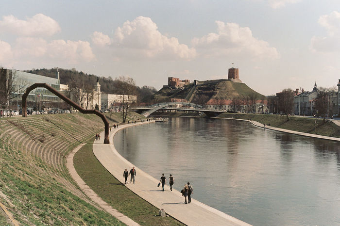 Gediminas Tower with signs of collapsing and the Neris River landscape Vilnius, Lithuania Architecture Autumn Castle Clouds Collapse Daylight Fall Gediminas Tower Gediminastower Green Landscape Modern Nature Neris Neris River Old Town People River Spring Tower Urban Village Vilnius Vilnius Old Town Winter