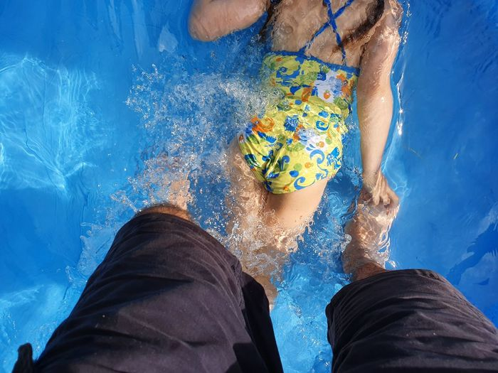 Low section of people in swimming pool
