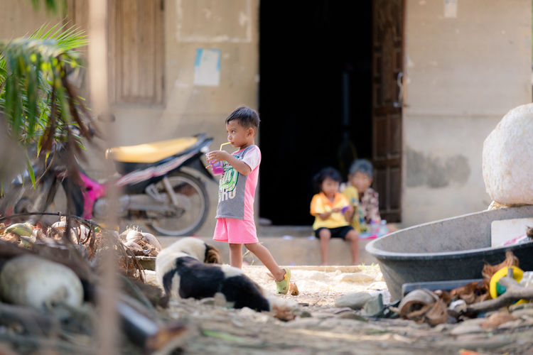 Child Real People One Person Childhood Women Females Lifestyles Day Architecture Casual Clothing Built Structure Selective Focus Girls Building Exterior Leisure Activity Full Length Innocence Outdoors