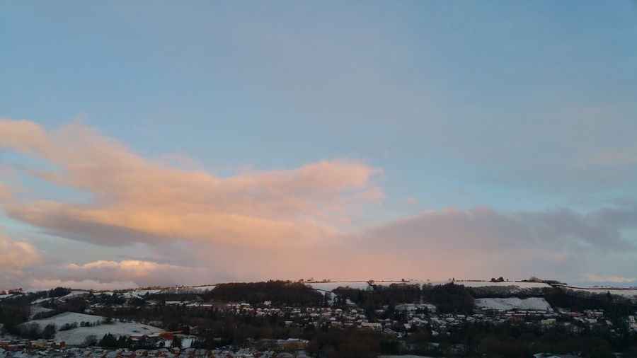 Townscape against sky during sunset