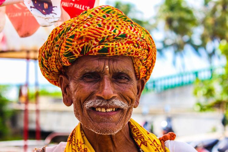 Portrait of smiling senior man wearing turban
