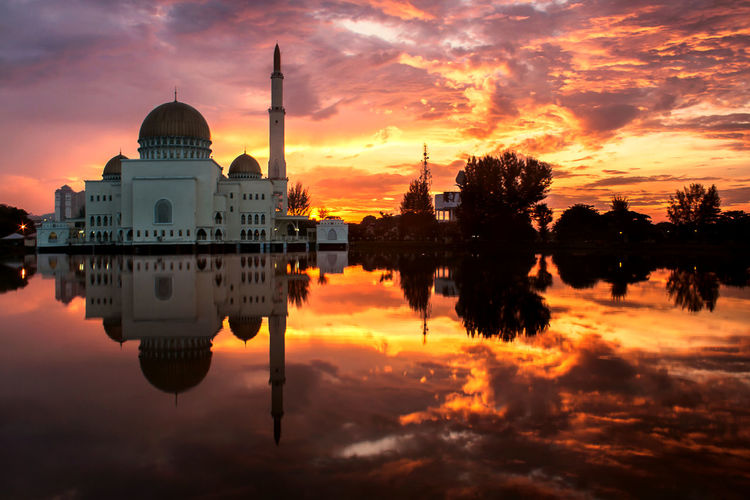 mosque with dramatic sunrise
