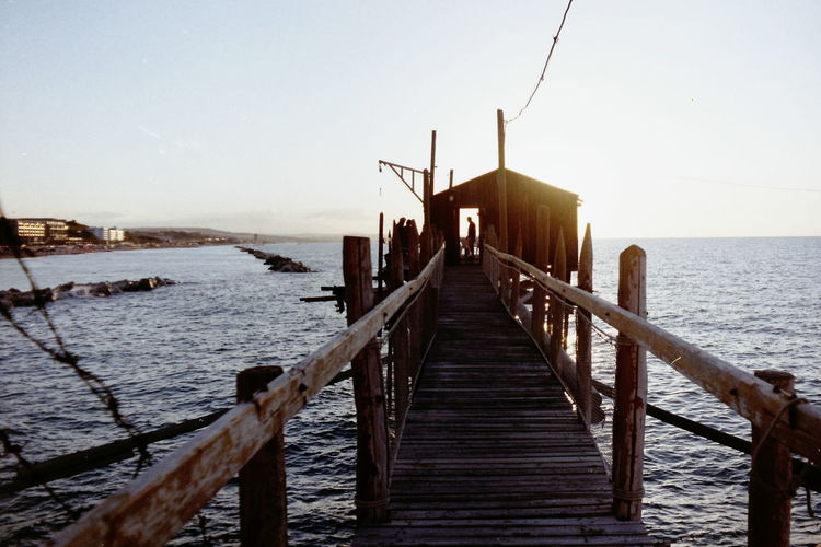 Horizon Over Water Beauty In Nature Wood - Material Sunset Sky Water Sea Vacations No Edits No Filters Fujifilm Film Photography Perspective Trabucco Italy Superia Pentacon Film Is Not Dead Outdoors Seaside Summer Wooden Structure Fishing Nature Landscape Bridge View