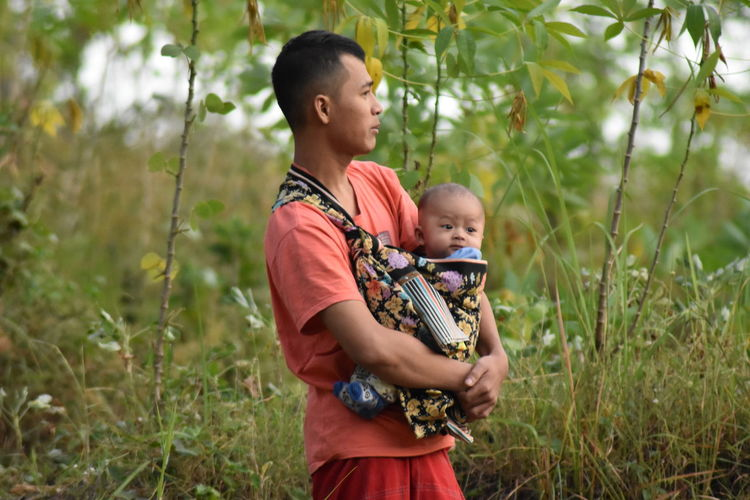 Father and baby girl with plants