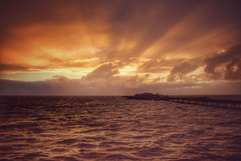 Weston-Super-Mare old pier as the sun sets behind stormy clouds. Sunset #sun #clouds #skylovers #sky #nature #beautifulinnature #naturalbeauty #photography #landscape