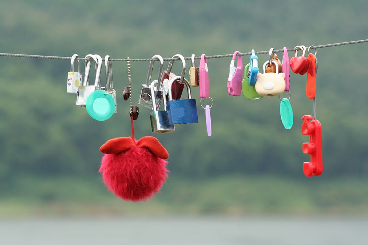 Lovers locks and doll hanging on the new bridge Group Doi Saket Day Valentine Thailand Chiang Mai Landmark Lockers Natural Closeup Symbolize Lovers Green Cable Wire Railing Marriage  Friendship Metallic Wedding Message Outdoors Happiness Sign Object Vintage New Summer Pattern Locker River Beautiful Symbol Hang Heart Couple Steel Romance LINE Metal Concept Background Padlock Lock Bridge Key Forever Love Cartoon Doll