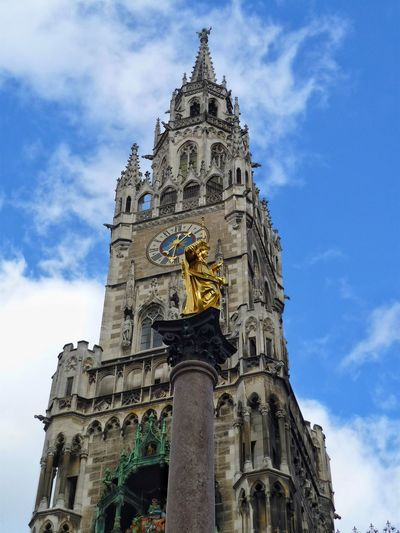 Munich - town hall and Virgin Mary EyeEm City Shots City Golden Golden Statue Marienplatz Mariensäule Maria Maria Statue EyeEm Gallery EyeEm Selects Town Hall Rathaus Munich Munich, Germany Architecture Low Angle View Architecture Statue History Cloud - Sky Sky Travel Destinations Religion Building Exterior Sculpture Outdoors No People Politics And Government The Graphic City