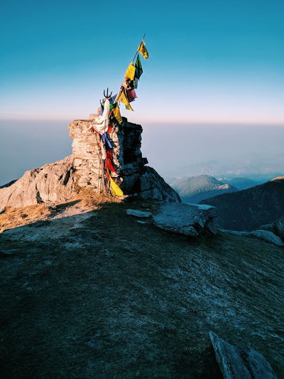 Praying flags on mountain against sky