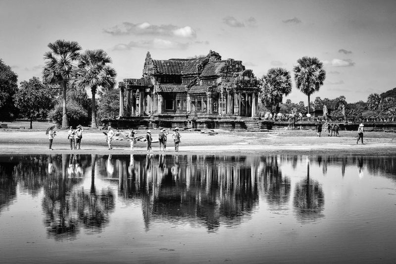 Ancient Ruins Angkor Wat Cambodia Picoftheday Photooftheday Blackandwhite Photography Travel Photography Reflection Water Tree Sky Outdoors Day Architecture People