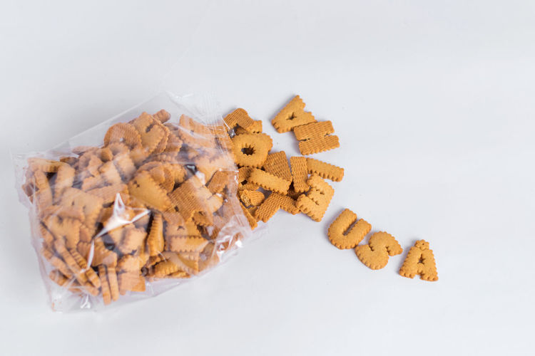 Alphabet Biscuits Carbohydrate - Food Type Cracker Crisp English Alphabet Food No People Plastic Bag Single Word Snack Studio Shot Text USA White Background