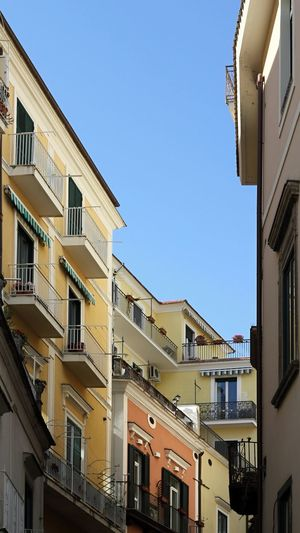 The blue of the sky between the colorful buildings of Amalfi, Italy. Beautiful Mediterranean  Travel Travel Photography View Architecture Balcony Blue Building Exterior Built Structure City Clear Sky Day Low Angle View No People Old Outdoors Residential Building Sky Tourism Tourism Destination Travel Destinations Urban Urban Skyline Window