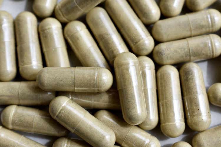 Full frame shot of capsules on table
