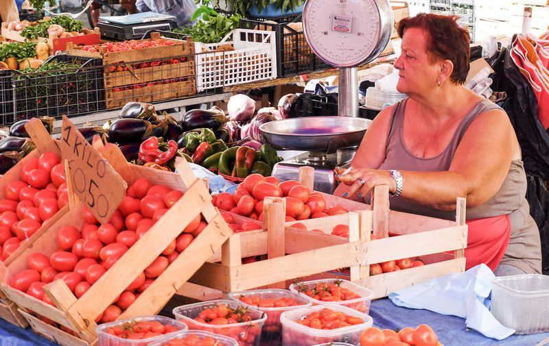 tomatoes for sale in Catania, Sicily, Italy Catania Street Photography Streetphotography Sicily Market Market Stall For Sale Vegetable Fruit Small Business Market Vendor Tomatoes