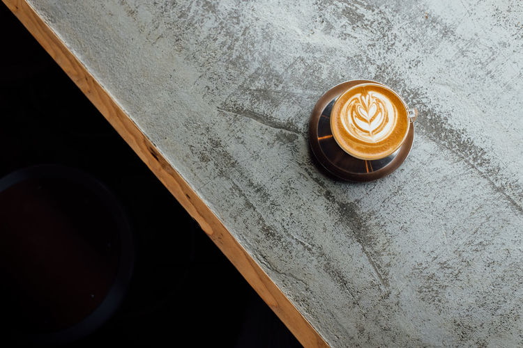 High angle view on a cup of coffee on a concrete table with window light Coffee Time Japan Latte Tokyo Tokyo,Japan Coffee - Drink Coffee Cup Concrete Concrete Table Concrete Texture Concretedesign Directly Above Drink Food And Drink Frothy Drink High Angle View Latte Latte Art Latte Art Lover Latte Photography Latteart No People Table Tokyo Coffee S Window Light
