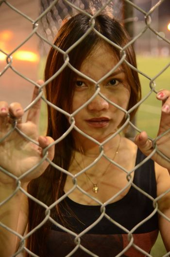 Confidence  Face Fence Individuality Looking At Camera Model Protection Young Women