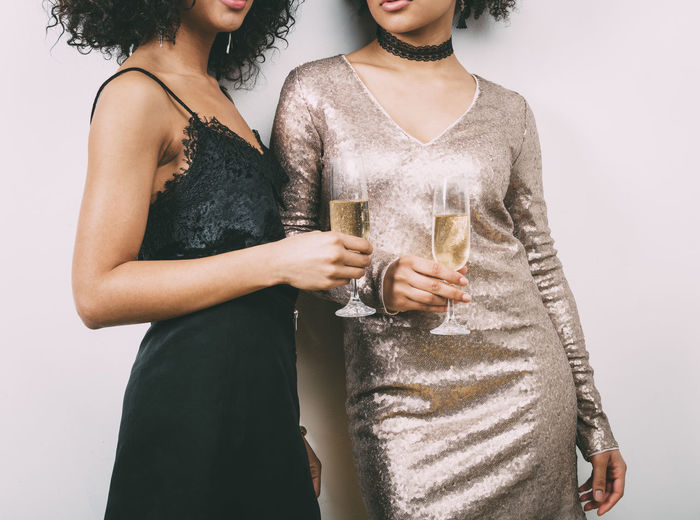 African American Afrohair Alcohol Best Friends Birthday Brunette Celebration Champagne Dress Drink Drinking Glass Evening Gown Holding Indoors  Only Women Party Time Standing Togetherness Two People Womans Day Women Young Adult Young Women