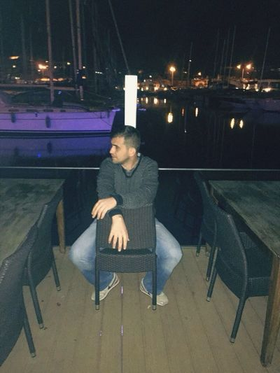 Night Sitting Illuminated Lifestyles Bench One Person Full Length Leisure Activity Pensive Real People Portrait Young Adult Outdoors