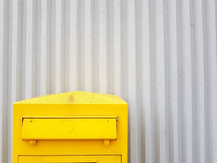 Close-up of yellow mailbox