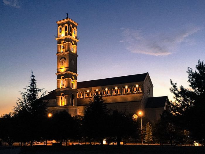 Vscokosova Architecture Illuminated Building Exterior Built Structure Tree Clock Tower Sky History Night Spirituality Religion Low Angle View Travel Destinations Outdoors Place Of Worship No People Clock Nature Kosovo Cathedral Mother Teresa PRISHTINA