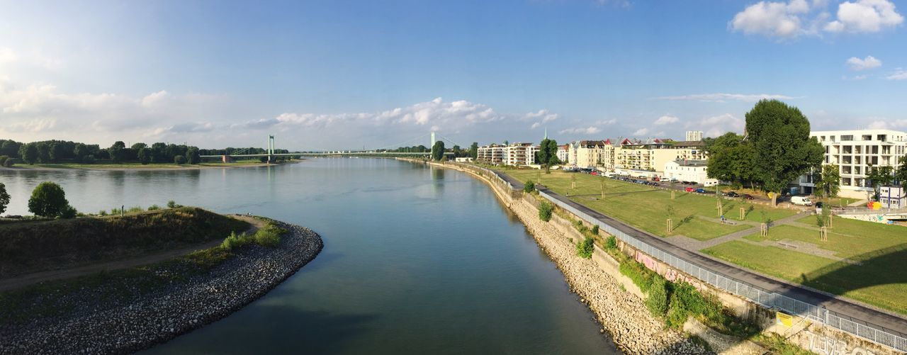 Scenic view of river rhine against sky in city