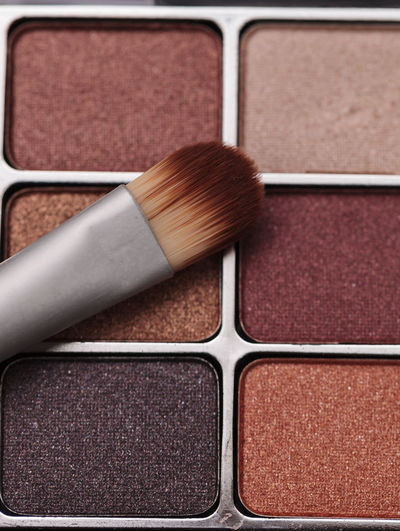 Close-Up Of Beauty Product With Make-Up Brush