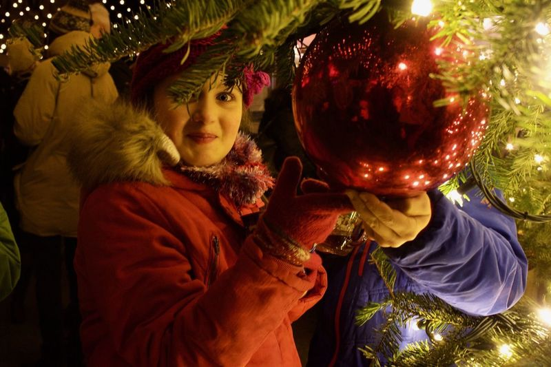 Young girl smiling and looking at christmas lights. Red Outdoor Girl Portrait Evening Sky Christmas Lights Christmas Lights Christmastime Christmas Market Christmas Bauble Girl Portrait christmas tree Christmas Decoration Christmas Decoration Real People One Person Lifestyles Celebration Holding Women Christmas Waist Up Holiday Clothing Females Christmas Decoration Decoration Indoors  christmas tree Leisure Activity Art And Craft