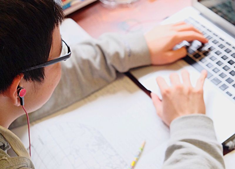 Working Eyeglasses  Lifestyles Communication Working Occupation Drawing - Activity Writing Technology Education High School High School Memories Homework Homework Time Research Research And Development Earphone Earphones Listening To Music Listen To Music Listening Copy Space EarPhonePlug Listen Audio Technica