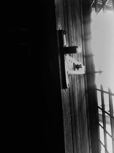 Close-up of wooden door in building